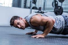A muscular man doing a pushups Stock Photography