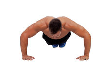 Muscular man doing pushups Royalty Free Stock Image
