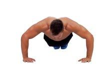 Muscular man doing pushups Royalty Free Stock Image