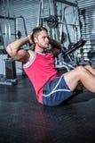 Muscular man doing sit-ups Stock Images