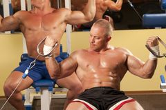 Muscular man doing weightlifting in gym Stock Photo