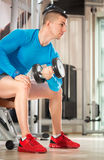 Muscular man doing  weights lifting. Fitness - powerful muscular man lifting weights Stock Photography