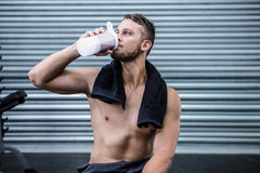 Muscular man drinking protein cocktail Royalty Free Stock Photos