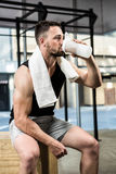 Muscular man drinking protein shake. At the crossfit gym royalty free stock photos