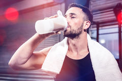 Muscular man drinking protein shake. At crossfit gym Royalty Free Stock Image