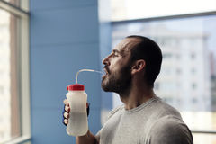 Muscular man drinking water Royalty Free Stock Photo