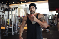 Muscular man drinking water Stock Photos