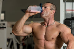 Muscular Man Drinking Water From Shaker Stock Images