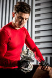 Muscular man with dumbbell Royalty Free Stock Image