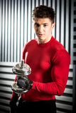 Muscular man with dumbbell Stock Photos