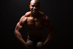Muscular man dumbbells Stock Photos