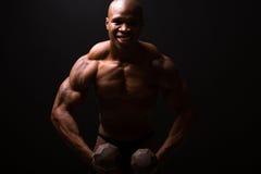Muscular man dumbbells Stock Photos