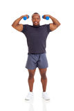 Muscular man dumbbells Stock Images