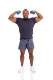 Muscular man dumbbells Stock Images