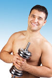 Muscular man with dumbbells on black background. Royalty Free Stock Photos