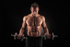 Muscular man with dumbbells on black background Royalty Free Stock Photos