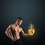 Muscular man with dumbbells on black background Stock Images