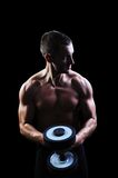 Muscular man exercise on a black background Royalty Free Stock Photography