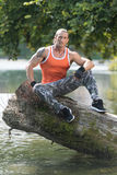 Muscular Man After Exercise Resting Outdoors In Nature Royalty Free Stock Photography