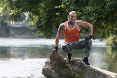 Muscular Man After Exercise Resting Outdoors In Nature Stock Photography