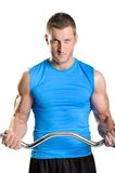 Muscular man exercise on a white background Stock Photo