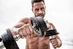 Muscular man exercising with barbell. fitness health diet. man sportsman with strong ab torso. steroids. athletic body stock photo