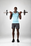 Muscular man exercising with barbell Royalty Free Stock Photo