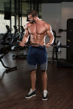 Muscular Man Exercising Biceps With Barbell Royalty Free Stock Photography