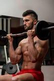 Muscular Man Exercising Biceps Stock Photo