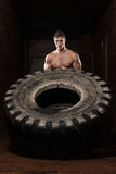 Muscular Man Exercising Crossfit Workout By Tire Flip Stock Photos