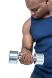 Muscular man exercising with dumbbell Royalty Free Stock Images