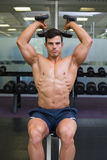 Muscular man exercising with dumbbells in gym Royalty Free Stock Image
