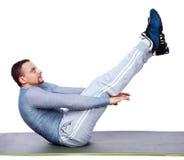 Muscular man exercising on exercise mat Stock Image