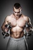 Muscular man exercising Royalty Free Stock Images