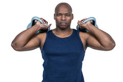 Muscular man exercising with kettlebell Royalty Free Stock Image