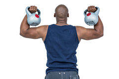 Muscular man exercising with kettlebell Stock Image