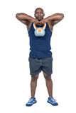 Muscular man exercising with kettlebell Stock Photo