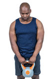 Muscular man exercising with kettlebell Royalty Free Stock Images