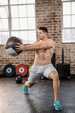 Muscular man exercising with medicine ball Royalty Free Stock Image