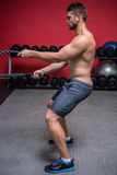 Muscular man exercising with rope Stock Photography
