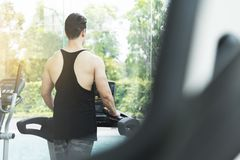 Muscular man exercising on treadmill machine. With copy space Royalty Free Stock Photos