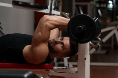 Muscular Man Exercising Triceps With Barbell Stock Photography