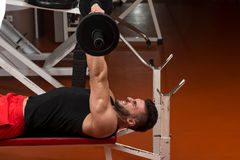 Muscular Man Exercising Triceps With Barbell Royalty Free Stock Photography