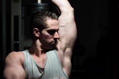 Muscular Man Exercising Triceps Royalty Free Stock Photos