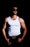 Muscular man in a fashion pose Royalty Free Stock Photos