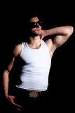 muscular man in a fashion pose Royalty Free Stock Photo