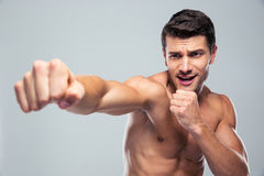 Muscular man fighting Royalty Free Stock Photo