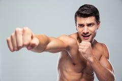 Muscular man fighting Royalty Free Stock Photo