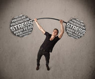 Muscular man fighting with stress Stock Images
