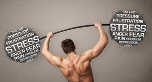 Muscular man fighting with stress Royalty Free Stock Images